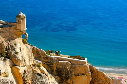 Alicante, Spain - Santa Barbara Castle, turret and blue sea - Alicante Airport car hire
