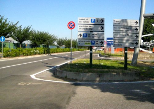 Bologna, Italy - Bologna Airport roundabout sign for goldcar and locauto - Bologna Airport car hire