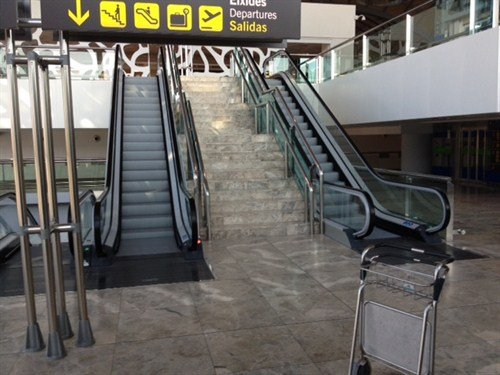 Escalators to the security screening area at Alicante Airport