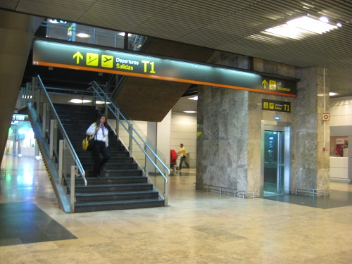 Madrid Airport T1 - Stairs and lift to departures: Madrid Airport car hire
