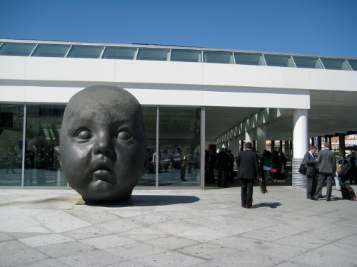Madrid Atocha Railway Station - giant head outside: Madrid Atocha Station car hire